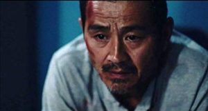 Lao Shi (Gang Chen)'s life inexorably falls apart in Johnny Ma's Old Stone (2016)