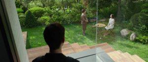 Ki-woo (Choi Woo-sik) watches as Mrs Park (Jo Yeo-jeong) fires Moon-gwang (Lee Jeong-eun) in Bong Joon-ho's Parasite (2019)