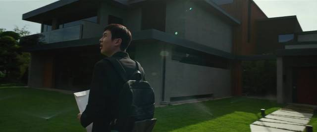 ... while the Parks live in a luxury, custom-designed mansion in Bong Joon-ho's Parasite (2019)