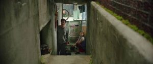 The Kims live in a slum basement in Bong Joon-ho's Parasite (2019)...