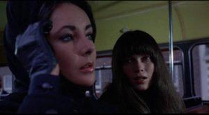 Cenci (Mia Farrow) approaches Leonora (Liz Taylor) on a London bus in Joseph Losey's Secret Ceremony (1968)