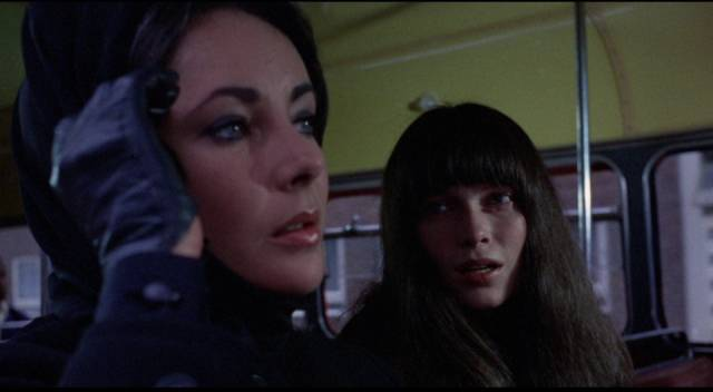Cenci (Mia Farrow) approaches Leonora (Liz Taylor) on a London bus in Joseph Losey's Secret Ceremony (1968)