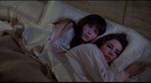 Cenci (Mia Farrow) and Leonora (Elizabeth Taylor) seek mutual comfort to ease their individual grief in Joseph Losey's Secret Ceremony (1968)