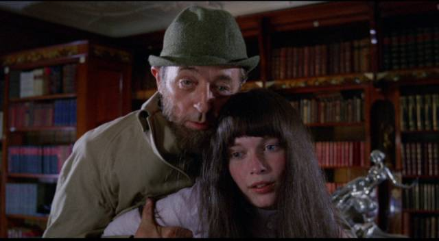 Stepfather Albert (Robert Mitchum) tries to reignite an incestuous relationship with Cenci (Mia Farrow) in Joseph Losey's Secret Ceremony (1968)