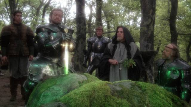 Frustrated knights try to pull the sword from the stone in John Boorman's Excalibur (1981)