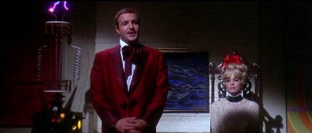Paul (James Caan) and Jennifer Montgomery (Katherine Ross) provide esoteric entertainment to party guests in Curtis Harrington's Games (1967)