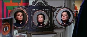 Lisa (Simone Signoret) has multiple layers of motivation and identity in Curtis Harrington's Games (1967)