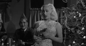 Mamie Van Doren entertains a Christmas party in Edward L. Cahn's Guns, Girls and Gangsters (1958)