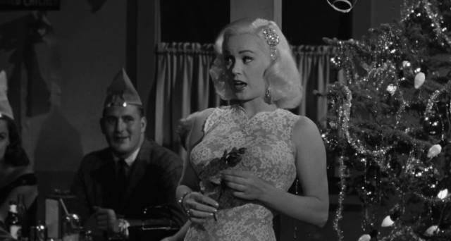Mamie Van Doren entertains a Christmas party in Edward L. Cahn's Guns, Girls and Gangsters (1958)
