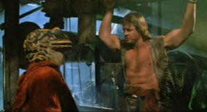 Roddy Piper is captured by amphibian mutants in R.J. Kizer & Donald G. Jackson's Hell Comes to Frogtown (1988)
