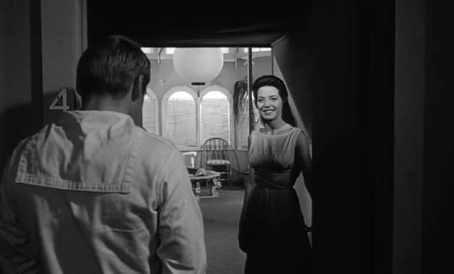 Johnny (Dennis Hopper) is drawn to mysterious sideshow performer Mora (Linda Lawson) in Curtis Harrington's Night Tide (1961)