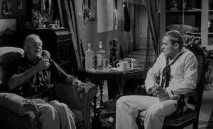 Captain Samuel Murdock (Gavin Muir) recounts the fantastical history of Mora (Linda Lawson) to Johnny (Dennis Hopper) in Curtis Harrington's Night Tide (1961)