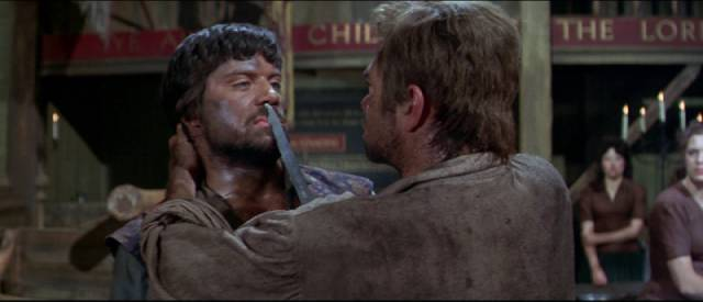 Brocaire (Oliver Reed) gets into a fight over a woman in John Gilling's The Pirates of Blood River (1962)