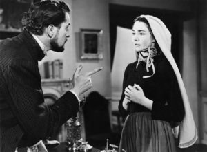 Prosecutor Vincent Price tries to get Bernadette (Jennifer Jones) to recant in Henry King's The Song of Bernadette (1943)