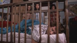 Mrs. Wadsworth (Ruth Roman) introduces social worker Ann Gentry (Anjanette Comer) to Baby (David Manzy) in Ted Post's The Baby (1973)