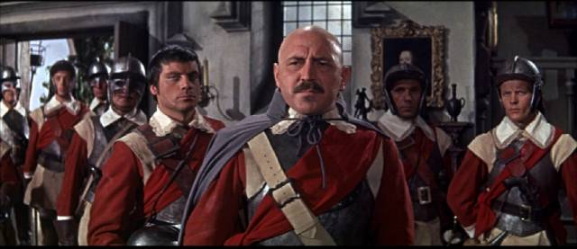 Fanatical Colonel Judd (Lionel Jeffries) and Captain Sylvester (Oliver Reed) ruthlessly pursue the Royalists in John Gilling's The Scarlet Blade (1963)