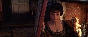 Clare Judd (June Thorburn) overhears secret plans in John Gilling's The Scarlet Blade (1063)