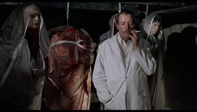 Joe Spinell enjoys his work in William Kennedy's The Undertaker (1988)