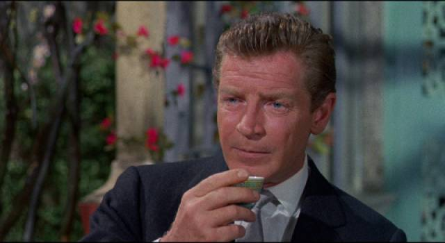 Don Benton (Richard Basehart), travel agent turned spy in Michael Carreras' Visa to Canton (1960)