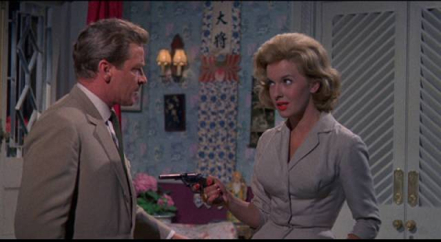 Don Benton (Richard Basehart) isn't sure which side Lola Sanchez (Lisa Gastoni) is on in Michael Carreras' Visa to Canton (1960)