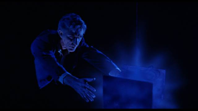 Dr. Scott Nelson (Robert Lansing) looks for something inside the reactor in Irvin S. Yeaworth Jr's 4D Man (1959)