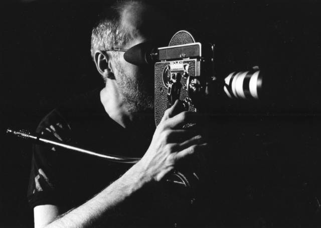 Director Kenneth George Godwin lining up an effects shot with the hand-wound Bolex