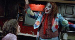 Tiny Tim as Mervo tries to entertain Jill (Itonia Salchek) in Bill Rebane's Bloody Harvest (1986)
