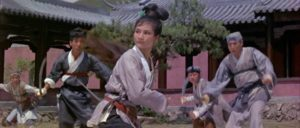 Golden Swallow (Cheng Pei-pei) fights the bandits on temple grounds in King Hu's Come Drink With Me (1966)