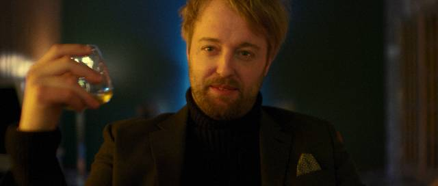 Polidori (Joshua Leonard) exploits Henry (David Call)'s obsession for personal profit in Larry Fessenden's Depraved (2019)