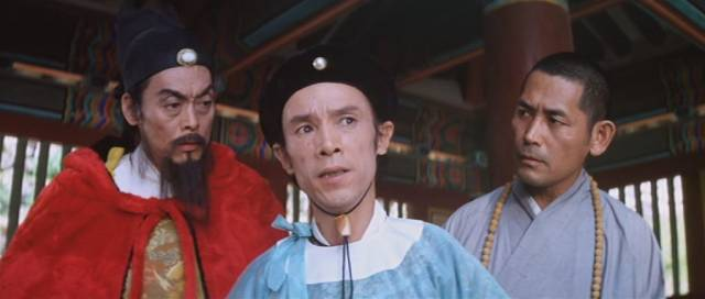 General Wang (Tien Feng) and his lieutenant Chang Cheng (Chen Hui-lou) are suspicious of other temple visitors in King Hu's Raining in the Mountain (1979)