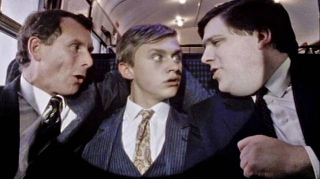 Businessmen offer career advice to a young man starting out in Ray Davies' Return to Waterloo (1984)