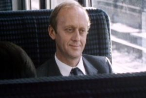 The Traveller (Kenneth Colley) on his commute to work in Ray Davies' Return to Waterloo (1984)