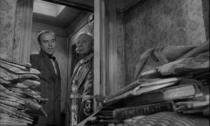 The indignity of having her life examined to gauge Mrs Ross (Edith Evans)' need in Bryan Forbes' The Whisperers (1967)