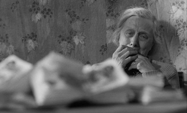 Mrs Ross (Edith Evans) finds the money hidden by her son and incorporates it into her fantasy in Bryan Forbes' The Whisperers (1967)