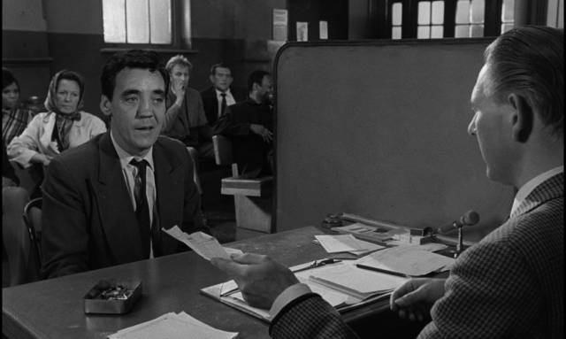 An atmosphere of distrust permeates the social assistance office in Bryan Forbes' The Whisperers (1967)