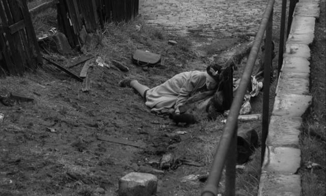 Mrs Ross (Edith Evans) is dumped in an alley by the Noonans in Bryan Forbes' The Whisperers (1967)