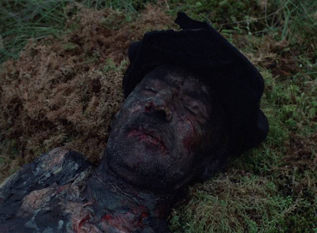 An old man burned and left to die by the Germans in Elem Klimov's Come and See (1985)