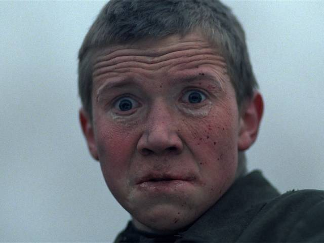 Flyora (Alexei Kravchenko) sinks deeper into madness as he witnesses horror after horror in Elem Klimov's Come and See (1985)