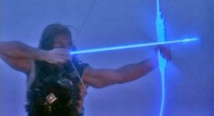 Ilias (Andrea Occhipinti) fights evil with his magic bow in Lucio Fulci's Conquest (1983)