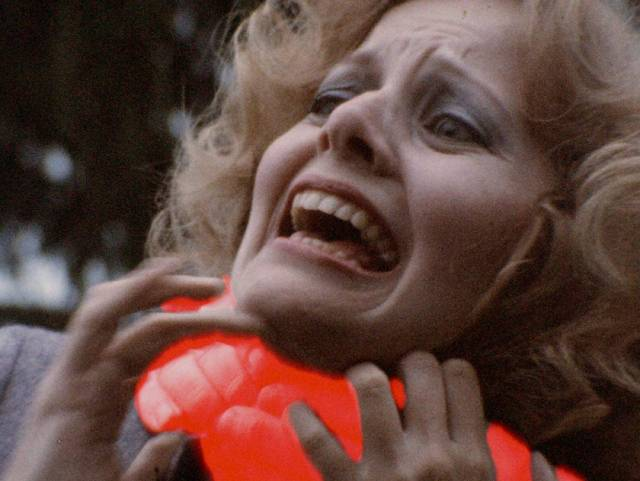 Eric Longfellow (Don Leifert) sucks the life force from one of his victims in Don Dohler's Fiend (1980)