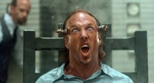 Killer Max Jenke (Brion James) enjoys his execution in James Isaac's House III: The Horror Show (1989)