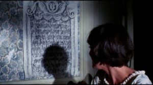 Jessica (Zohra Lampert) is drawn to graveyard artifacts in John Hancock's Let's Scare Jessica to Death (1971)