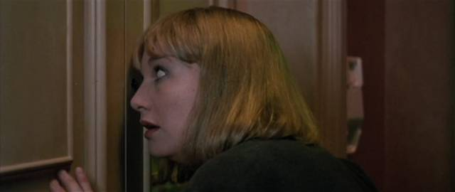 Betty's agent Mira (Daria Nicolodi) makes the mistake of looking through the door's spyhole in Dario Argento's Opera (1987)