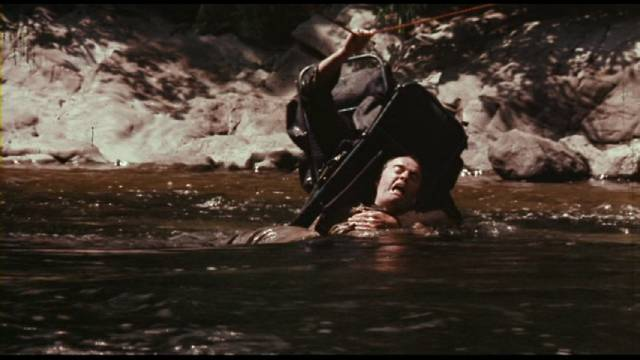 A dangerous river complicates the threat from a human adversary in Peter Carter's Rituals (1976)