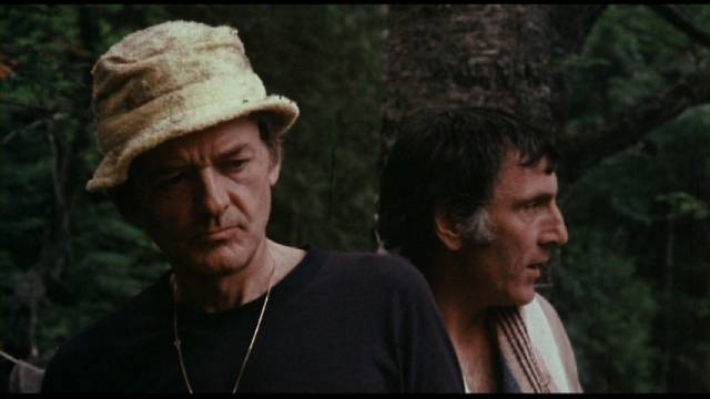 Harry (Hal Holbrook) is annoyed by Mitzi (Lawrence Dane)'s dubious morality in Peter Carter's Rituals (1976)