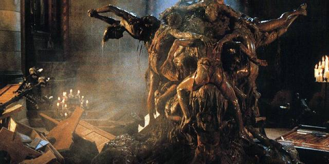 A writhing pile of victims rise from the pit beneath Michele Soavi's The Church (1989)