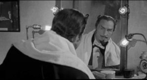 Don Gallico disguises himself as arch rival The Great Rinaldi in John Brahm's The Mad Magician (1954)