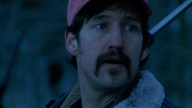 Otis (John Speredakos), a hunter with anger management issues, threatens a vacationing family in Larry Fessenden's Wendigo (2001)