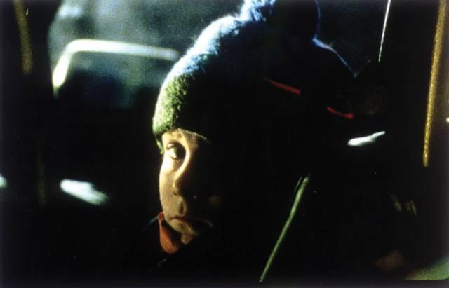 Miles (Erik Per Sullivan), faced with violent adult conflicts, has visions of the Wendigo in Larry Fessenden's Wendigo (2001)