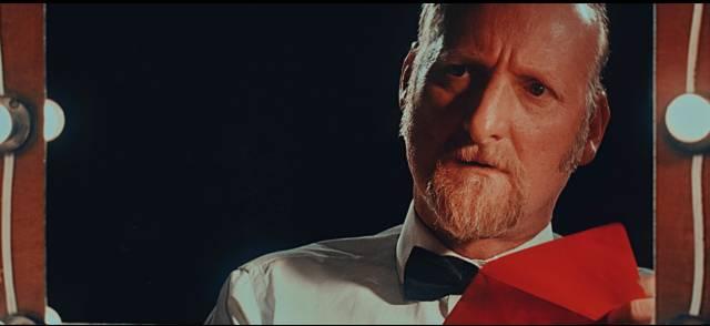 Magician Lorenzo Manzini (German Baudino) has identity issues in the Onetti Brothers' Abrakadabra (2018)